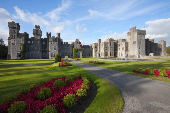 Irish Castle and hotel at sunny day in Ashford, Mayo, Ireland