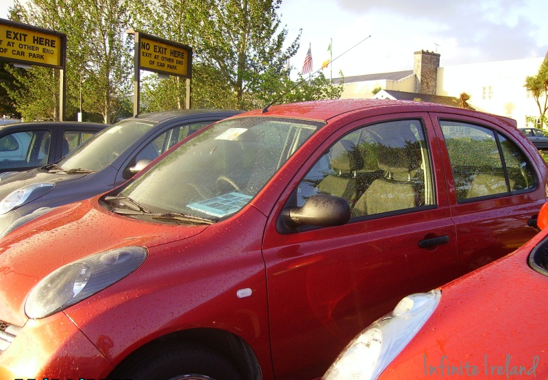 Red Nissan Micra Rental Car