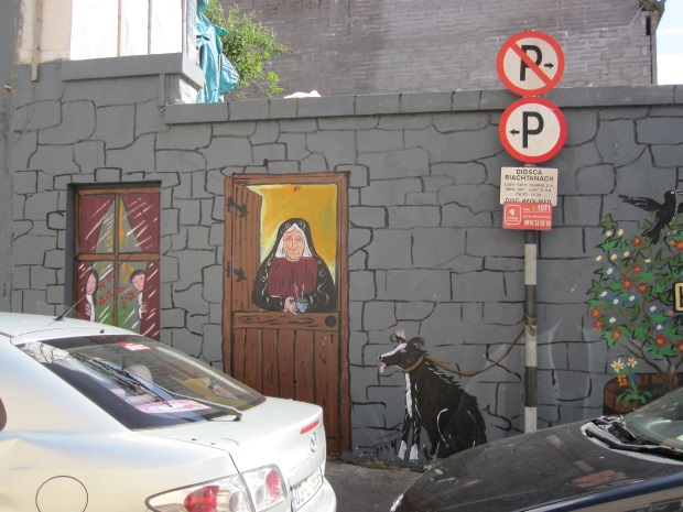 Mural and parking sign in cork