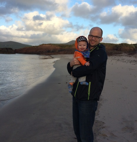 Baby on the beach with man