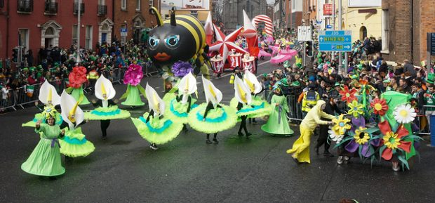 St. Patrick's Day Parade Dublin with people dress in calla lily costumes and a giant bee float