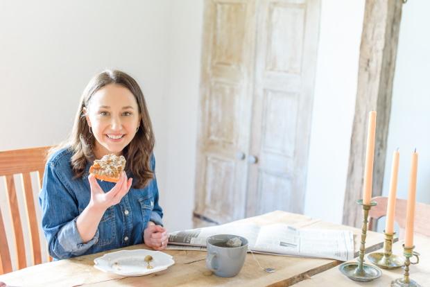 Stephanie eating a cinnamon bun